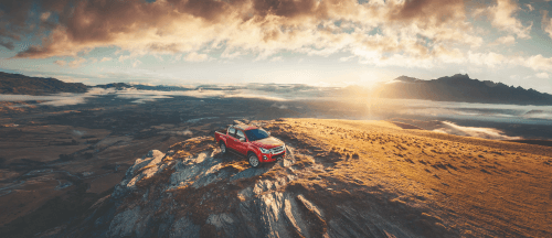 Isuzu D-Max in red with a stunning view